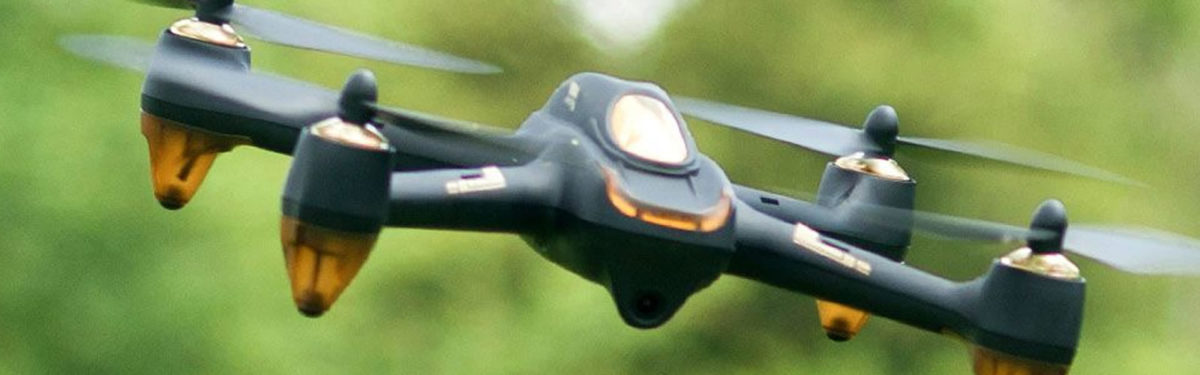 Remote control drone in flight with green background